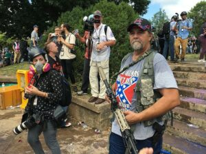 White supremacist holding a firearm
