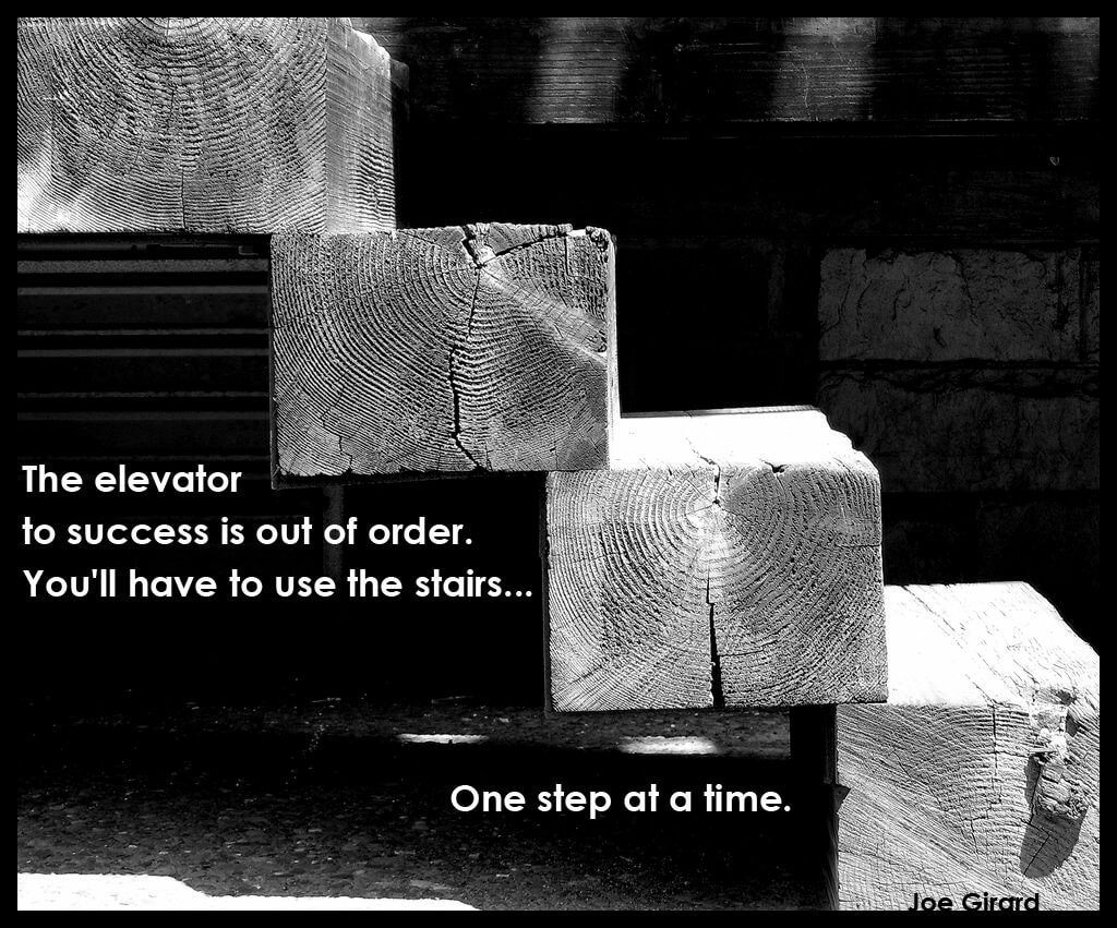 One step at a time quote, over image of steps