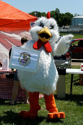 An employee dressed up in a chicken suit, advertising for Jimmy's BBQ