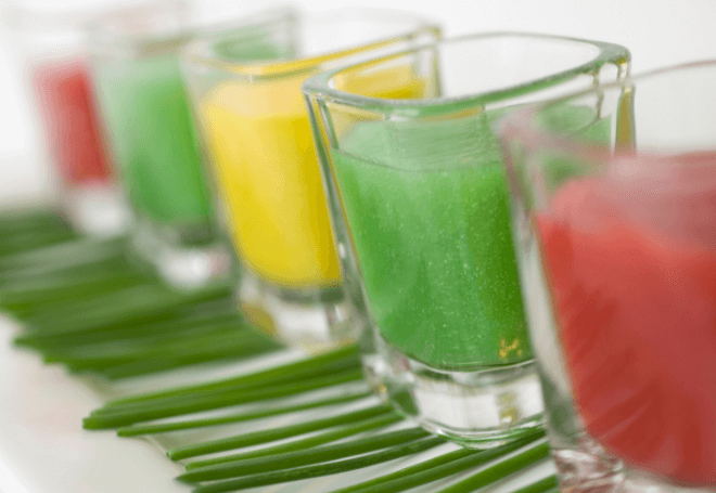 Green, Red, and Yellow Healthy smoothies in small glasses