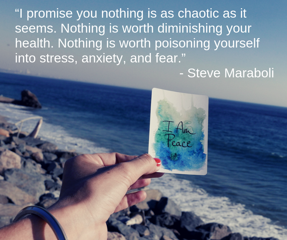 "A hand holding an illustration that says ""I am Peace"" in front of an ocean.  A quote over the image that says, ""I promise you nothing is as chaoatic as it seems.  Nothing is worth diminishing your health.  Nothing is worth poisoning yourself into stress, anxiety, an fear."""
