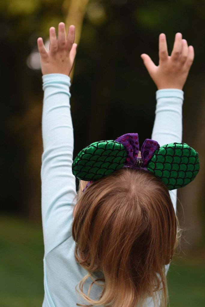 little girl in Ariel Micky Mouse Ears - Disney branding