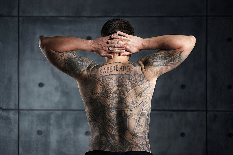 Man with tattoo on his back