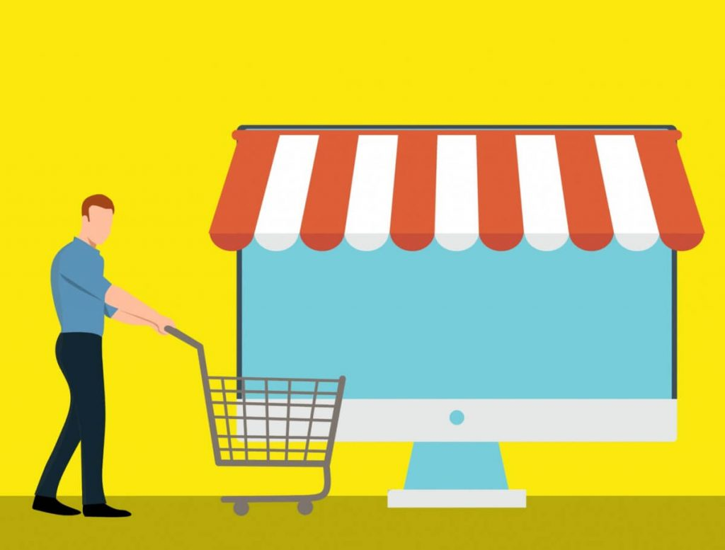 illustration of man with shopping cart in front of a computer that looks like a store.