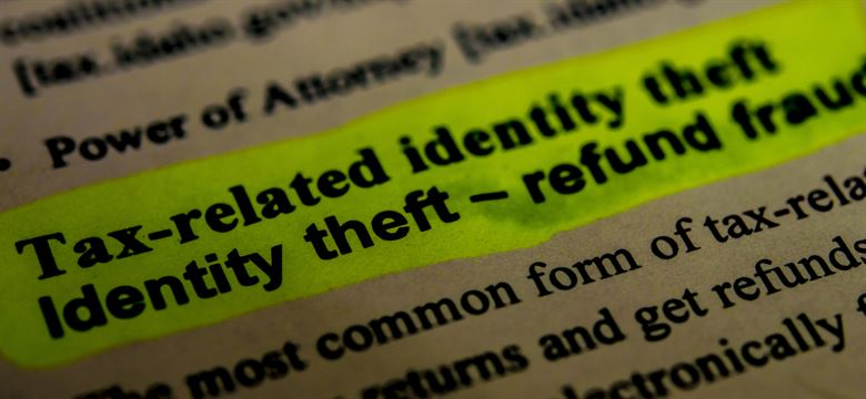 "Highlighted portion of a dictionary that says ""tax-related identity theft"""