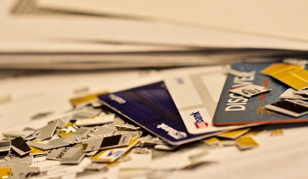 Cutting up old credit cards to protect yourself from identity theft.