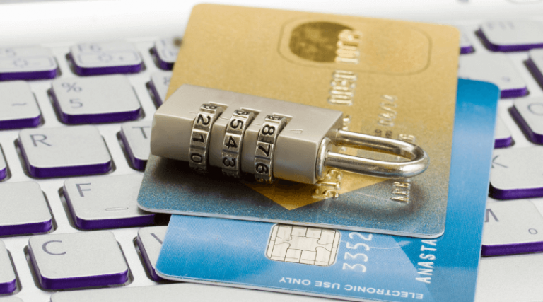 Lock on top of credit cards over a keyboard - protect yourself from identity theft