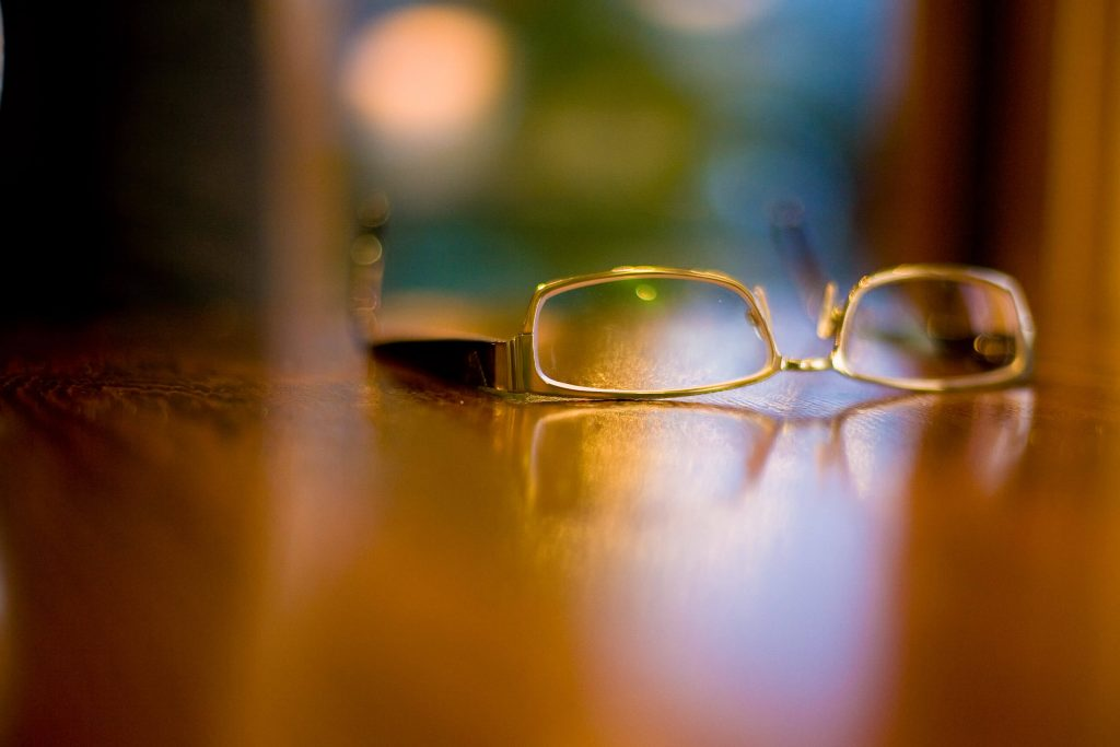 Reading glasses sitting on a table.