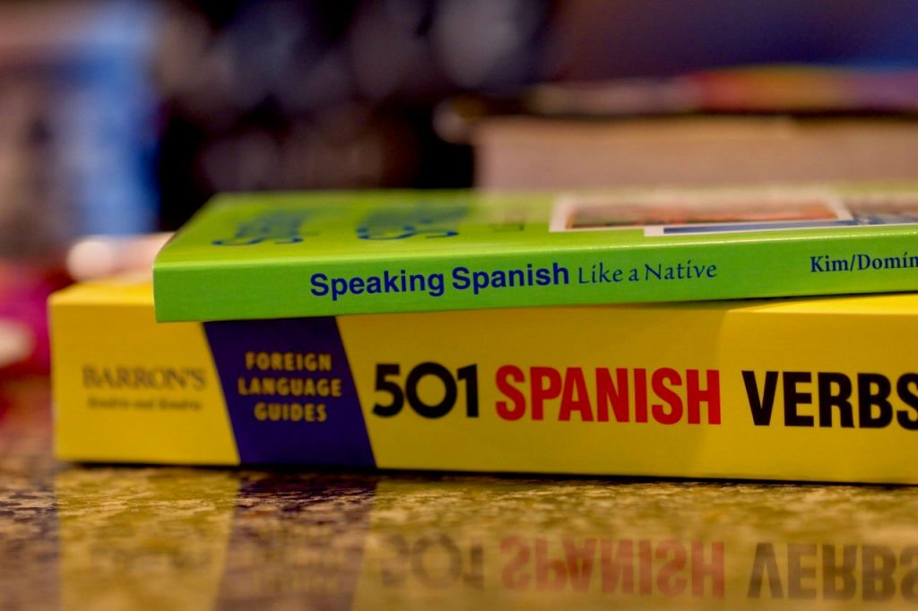 Photo of two Spanish books sitting on a table, available to use for translating.