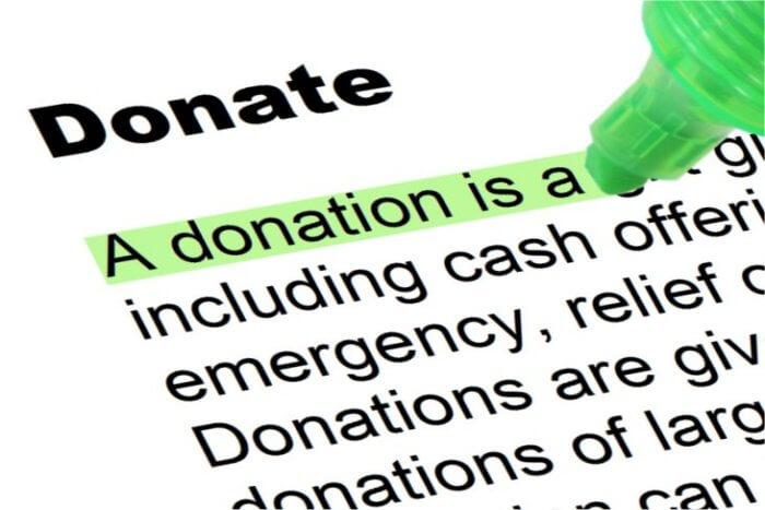 """Image of the definition of """"Donate,"""" with the definition being highlighted in green."""