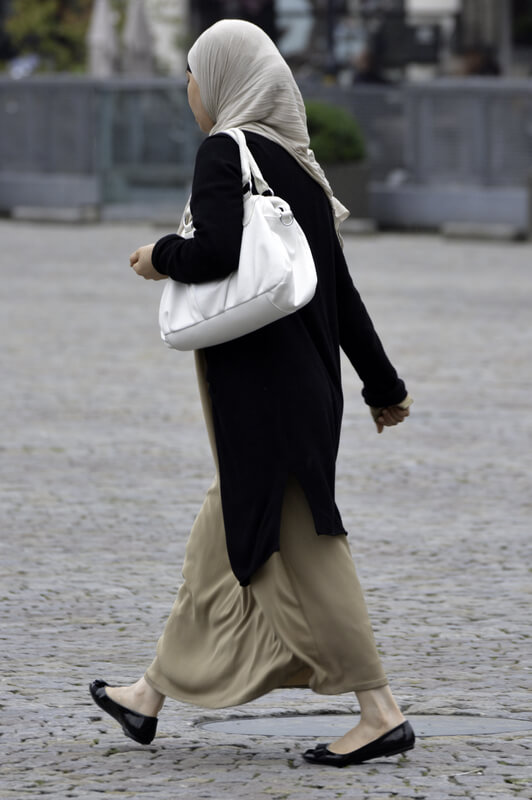 Photo of a woman wearing clothing that is traditional for her culture.