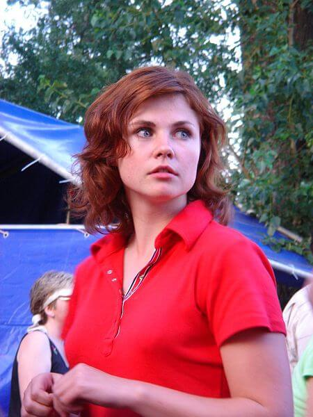 Photo of a woman wearing a red shirt.