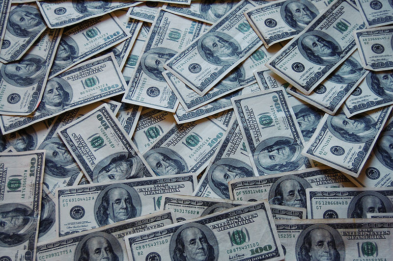 Photo of American dollars, indicating that going green can save you money.