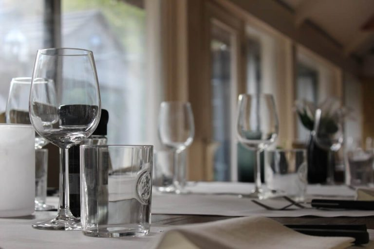 Image of a table set with wine and water glasses.