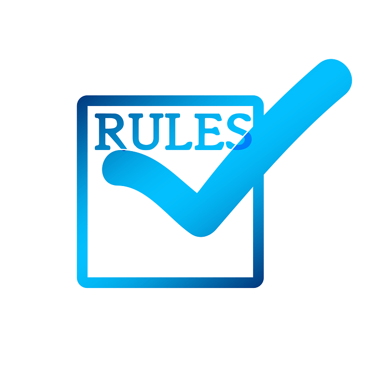 Image of a blue box with the word 'RULES' and a check mark inside the box, indicating the rules for M&E tax deductions.