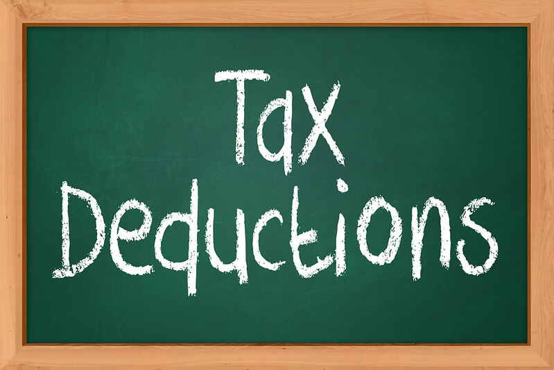 Image of a chalkboard with the words 'Tax Deductions.'