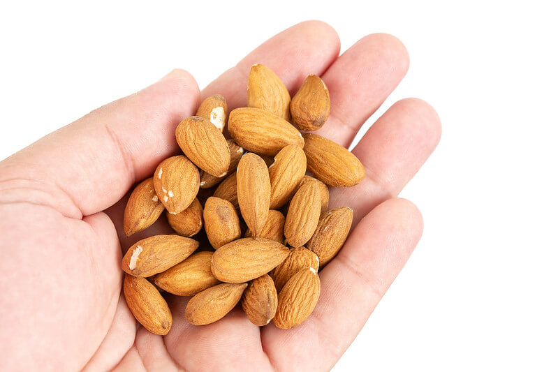 Photo of a handful of almonds, which help foster sleep.