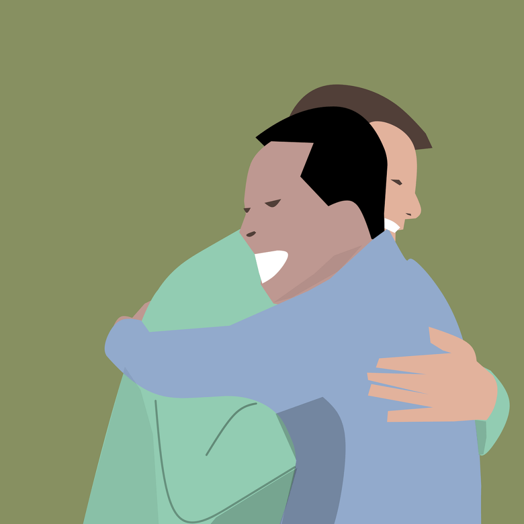 Image of two men in an embrace, happy about their business relationship.