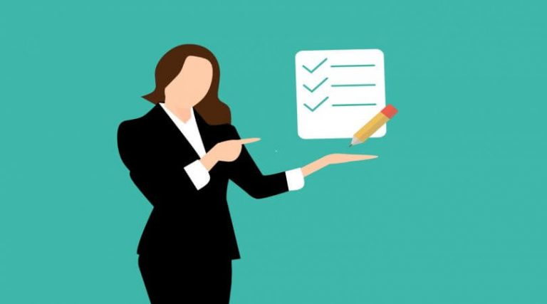 Image of a business woman holding up a checklist.