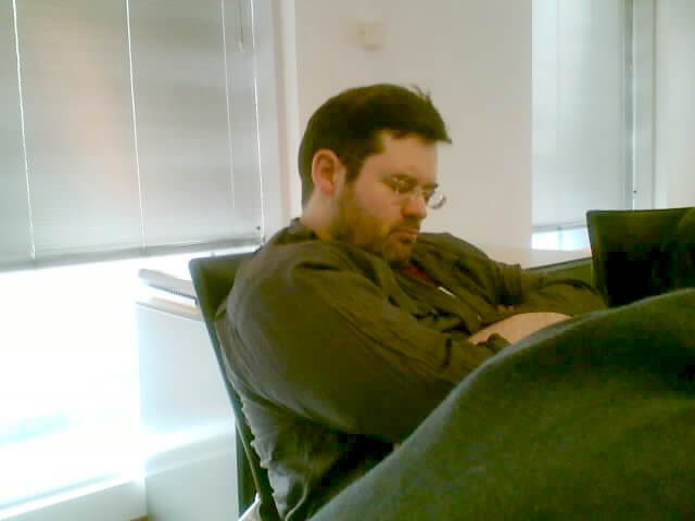 Photo of a man sleeping during  in an office chair.