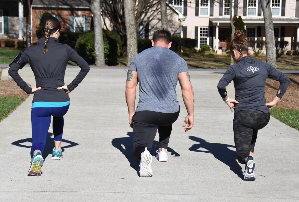 Photo of three people exercising as part of a New Year's resolution.