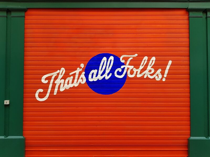 "Photo of a painted door with the words ""That's all folks!"""