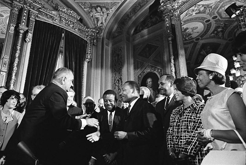 MLK and LBJ at the signing of the Voting Rights Act of 1965.