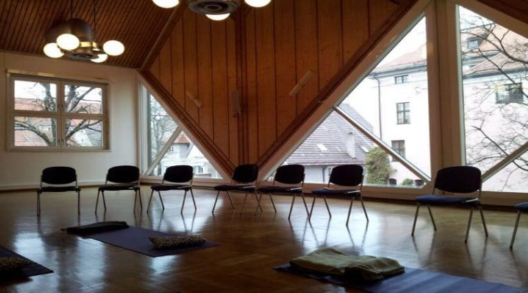Photo of chairs and mats in a meditation room.