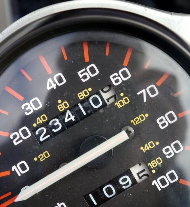 Picture of a speedometer and odometer showing mileage.