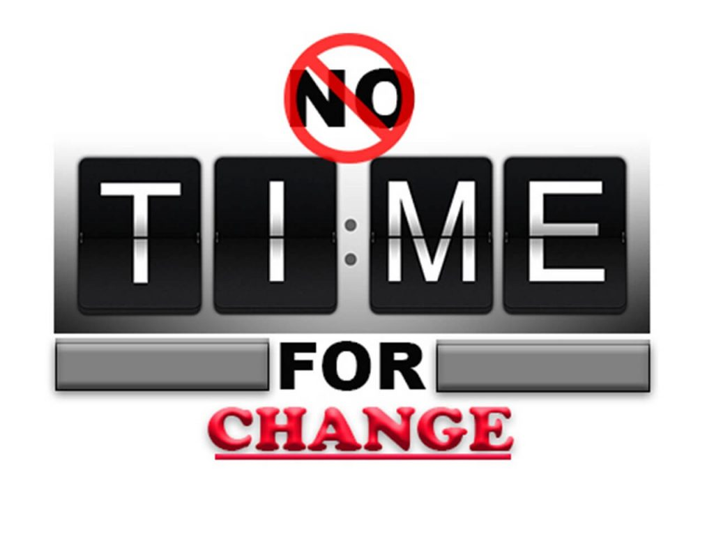 "Image of the words No TIME FOR CHANGE, with the ""no"" inside a slash indicating it is time for change."
