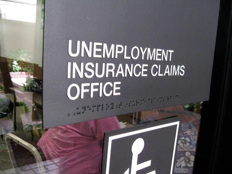 Photo of an UNEMPLOYMENT INSURANCE CLAIMS OFFICE sign.