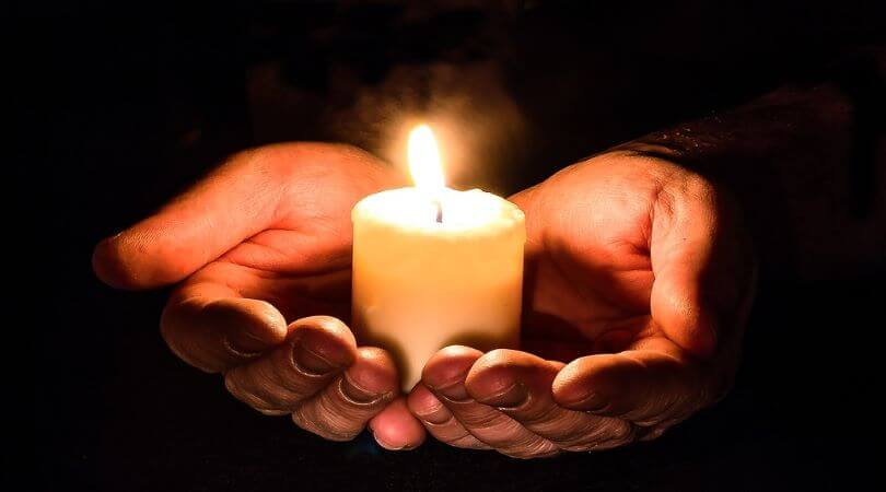 Photo of a hands holding a candle, symbolizing the saving grace of the Families First Coronavirus Response Act.