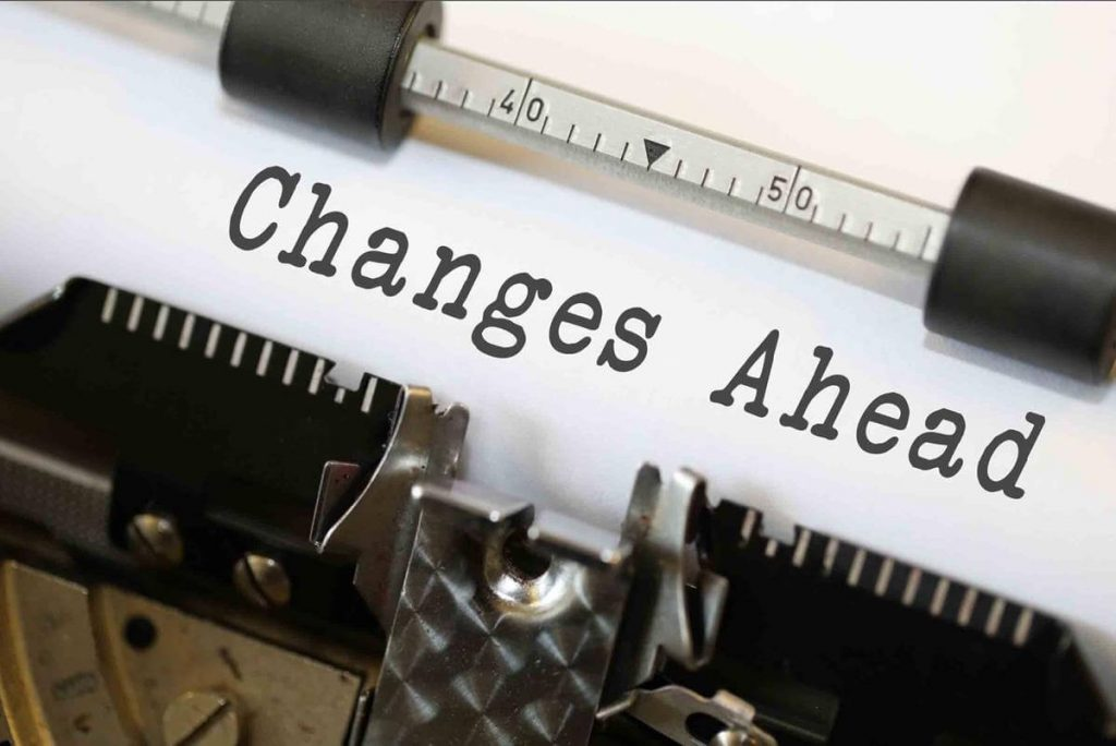"""A typewriter that has the words, """"Changes Ahead"""" typed out on the paper."""