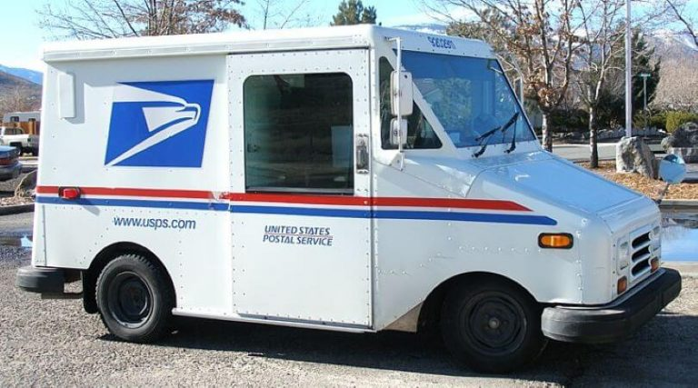 Photo of the side of a USPS delivery truck.