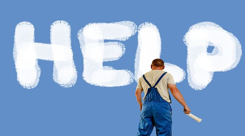 "Image of a blue background with the word ""HELP"" painted in white, and a man with a paintbrushs standing in the forefront."