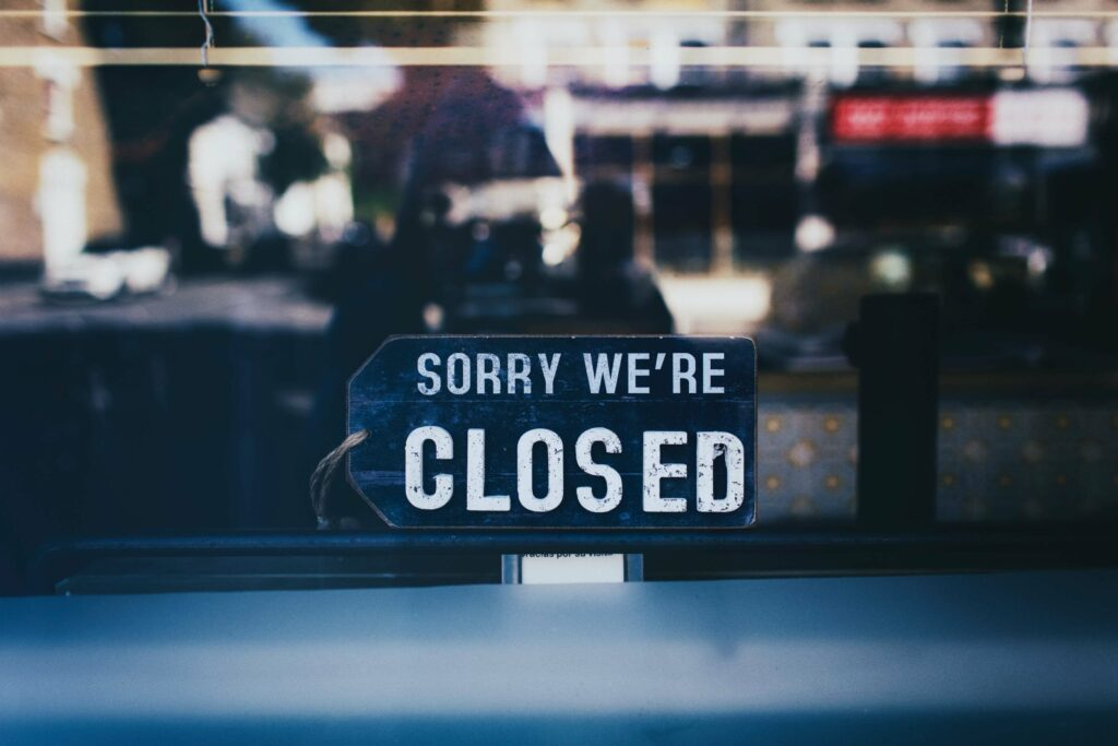 "Photo of a ""SORRY WE'RE CLOSED"" sign in front of a business, whose employees might need unemployment benefits."
