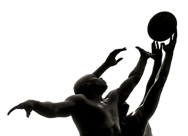 Image of basketball players going for a rebound.
