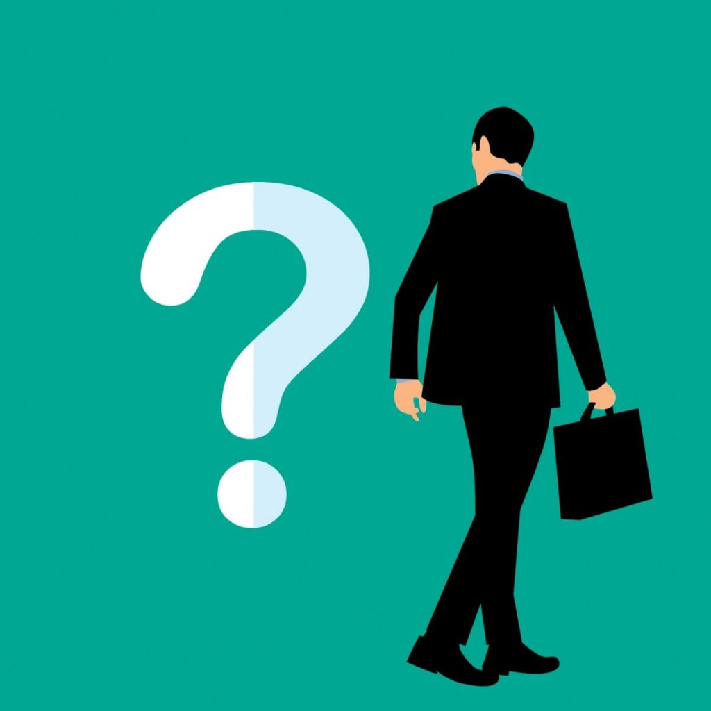 Image of a man, walking with a briefcase, and looking at a white question mark on the wall.