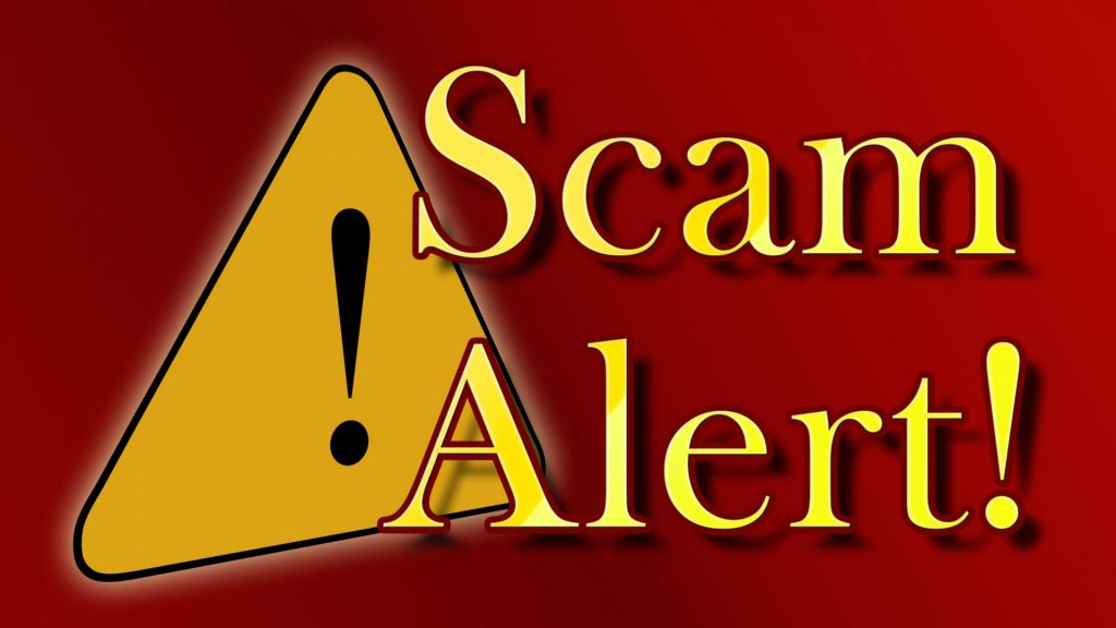 """Image of a caution symbol and the words """"Scam Alert!"""" warning of cyber attacks."""