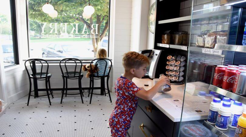 Photo of two children having a personalized customer experience at a bakery.
