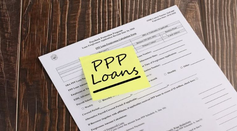 Image of a loan application, and a sticky note with PPP on it, as it relates to the Paycheck Protection Program update.