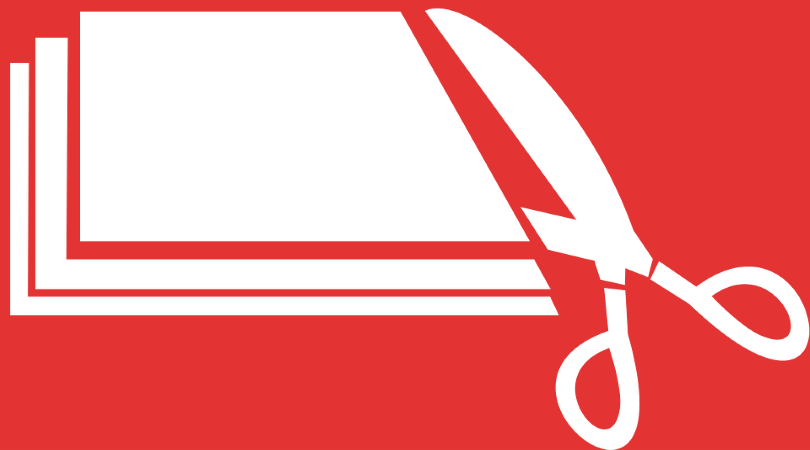 Image of a red background with white scissors cutting white paper, indicating the payroll tax cut.
