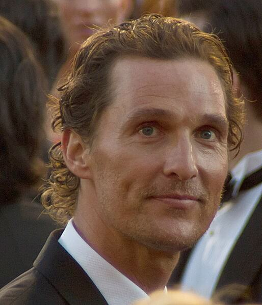 Photo of Matthew McConaughey with a slight smile on his face, looking past the camera.