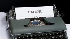 Photo of a typewriter with the word CANCEL typed on the paper.