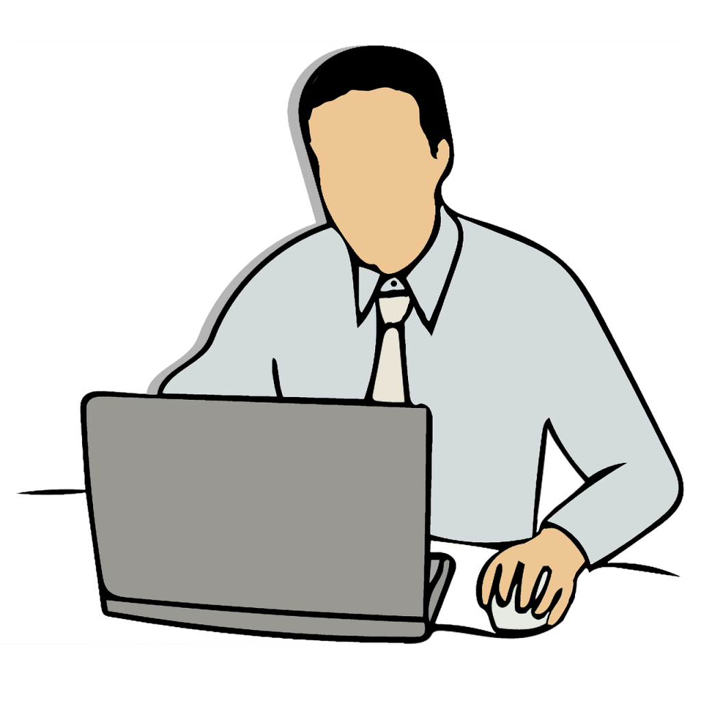 Image of a man in a shirt and tie sitting at a laptop computer on a table.