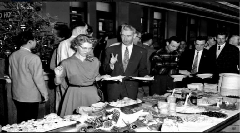 Old photo of a holiday office party.
