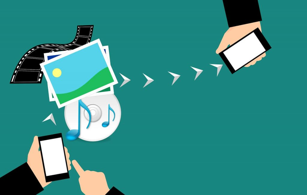 Image of hands job sharing images, music, and files to remain in communication with one another.