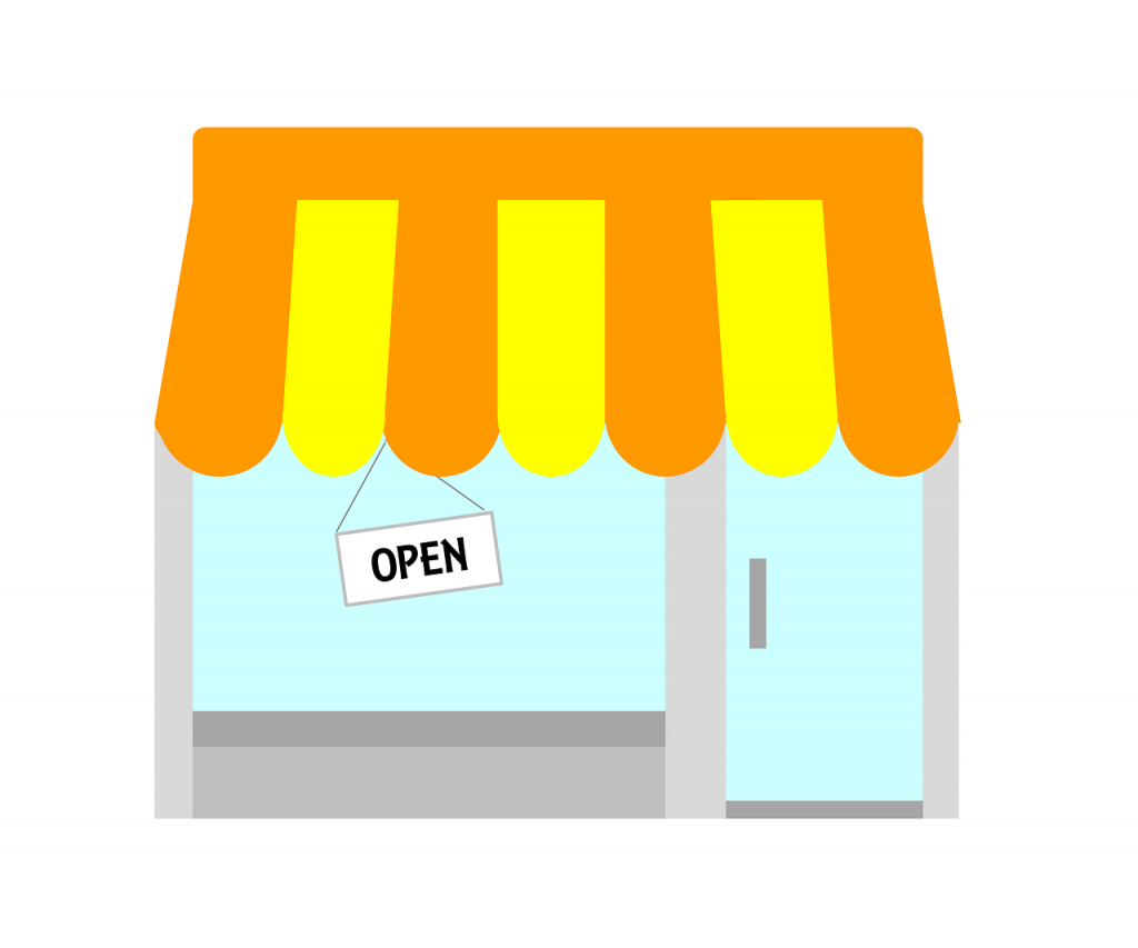Image of a small business storefront with an open sign in the window.