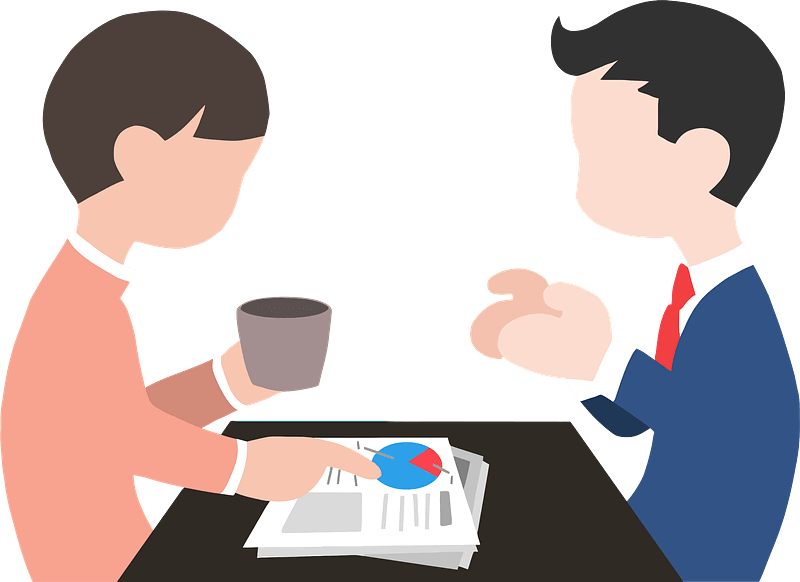Image of two employees job sharing and discussing their job.