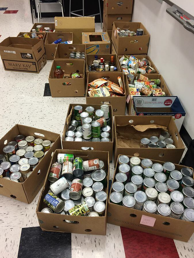 Photo of boxes of canned goods, which is an idea for a good team building event by doing a food drive.